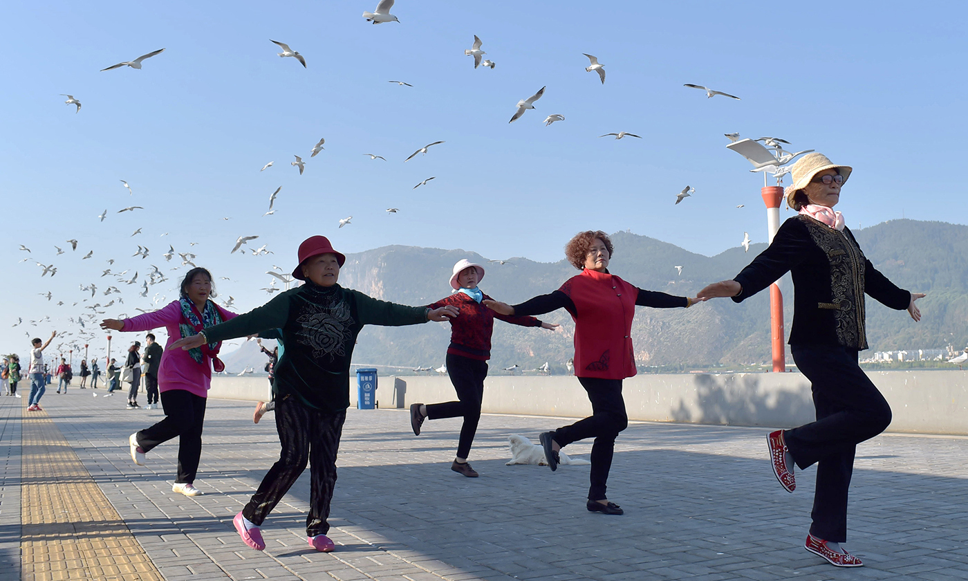 <p>Chinese pensioners exercise in a park. <em>Photo by Jie Zhao/Getty</em></p>