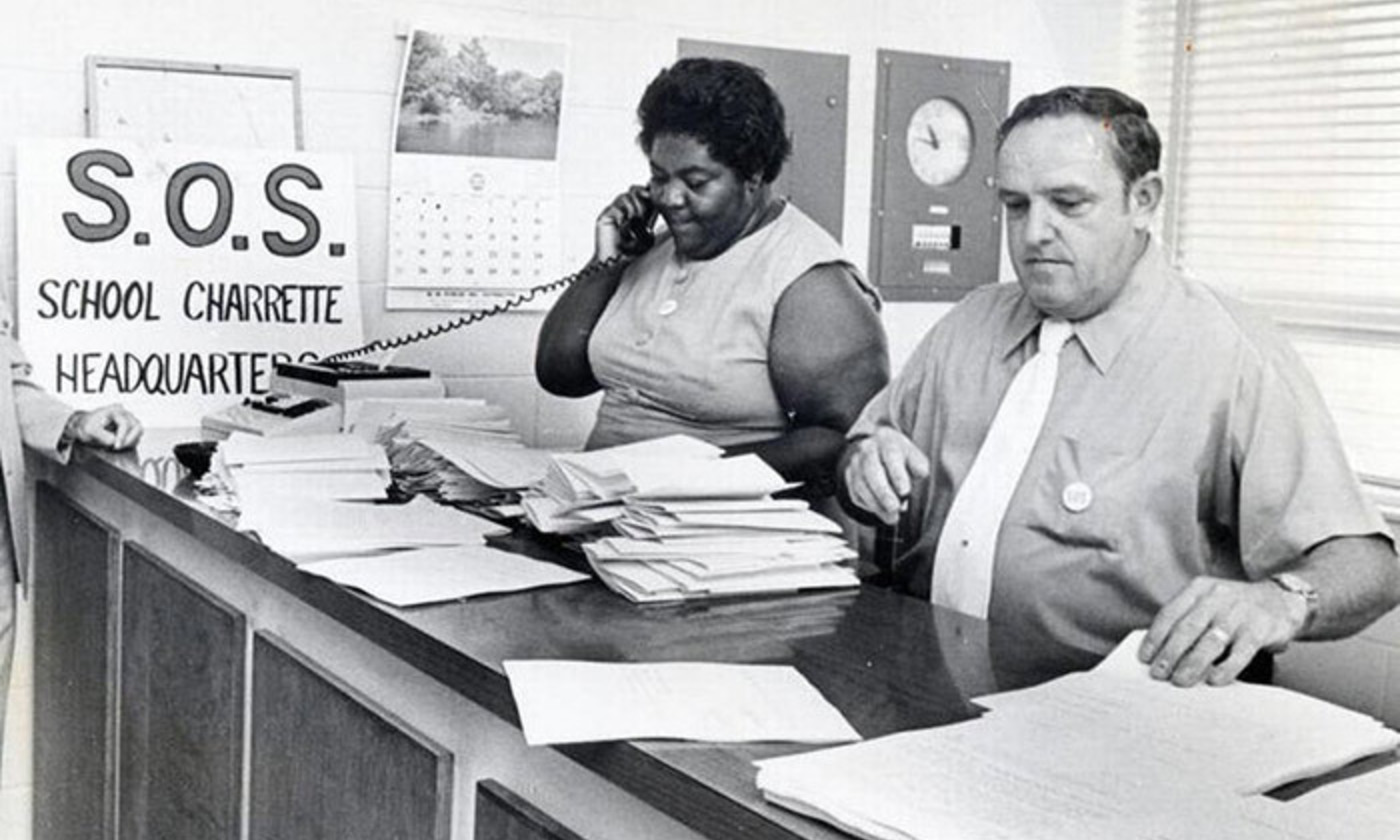 <p>Ann Atwater and C P Ellis, longtime enemies, chaired a 10-day community summit on desegregating Durham schools<em>, </em>'Save Our Schools' (SOS). <em>Photo by Jim Thornton, courtesy of The Herald-Sun Collection, University of North Carolina at Chapel Hill Libraries</em></p>