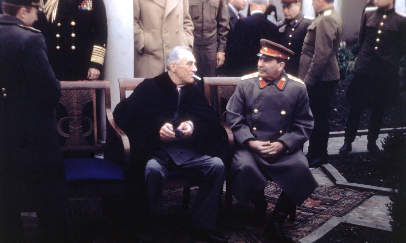 Roosevelt and Stalin share a moment at Yalta. <em>Getty Images</em>