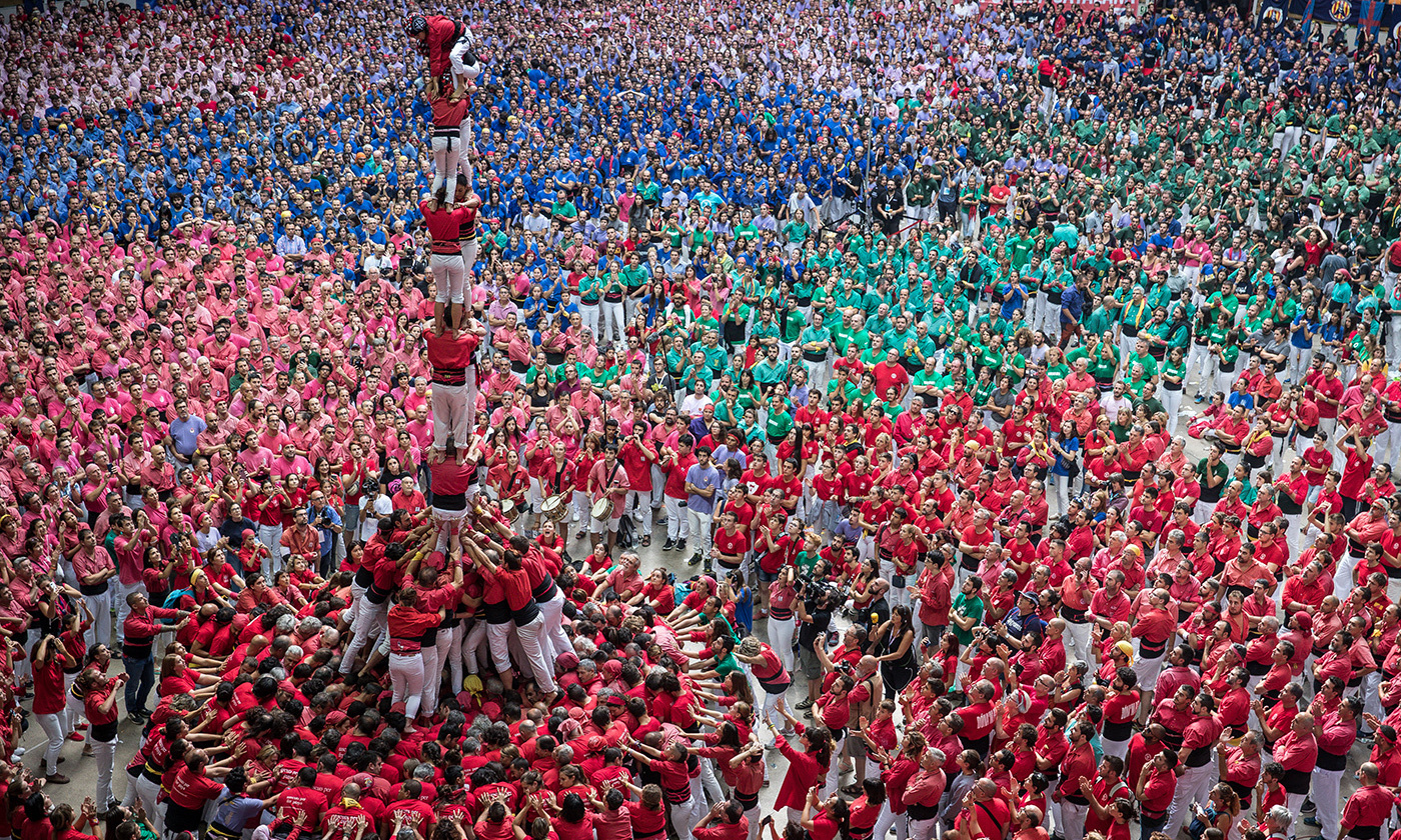 <p>Members of the Castellers de Barcelona build a human tower in Tarragona, Spain, October 2007. <em>Photo by Maja Hitij/Getty </em></p>