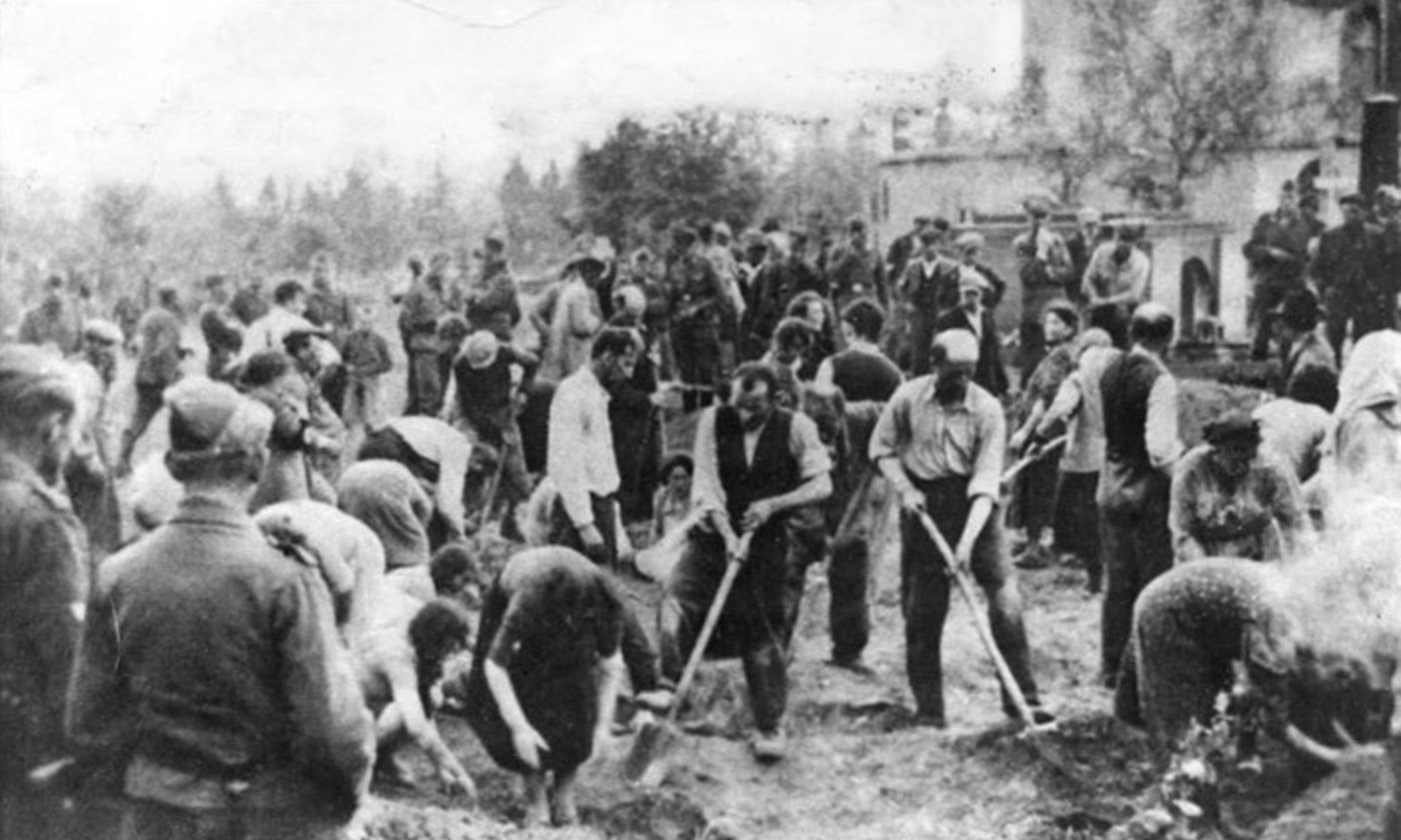 <p>Jewish people forced to dig their own graves in Ukraine, 1941. <em>Photo courtesy the German State Archives/Bundesarchiv</em></p>
