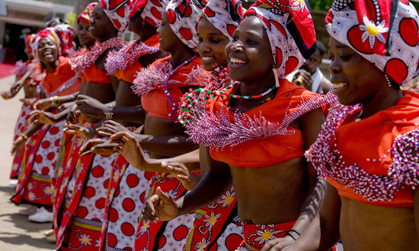 <p>Dancers in traditional dress, Kenya. <em>Photo by Kate Holt/Flickr</em></p>